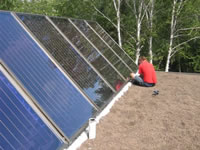 Solar panels for hot-water and heating being installed on the BioHaus Green Roof.